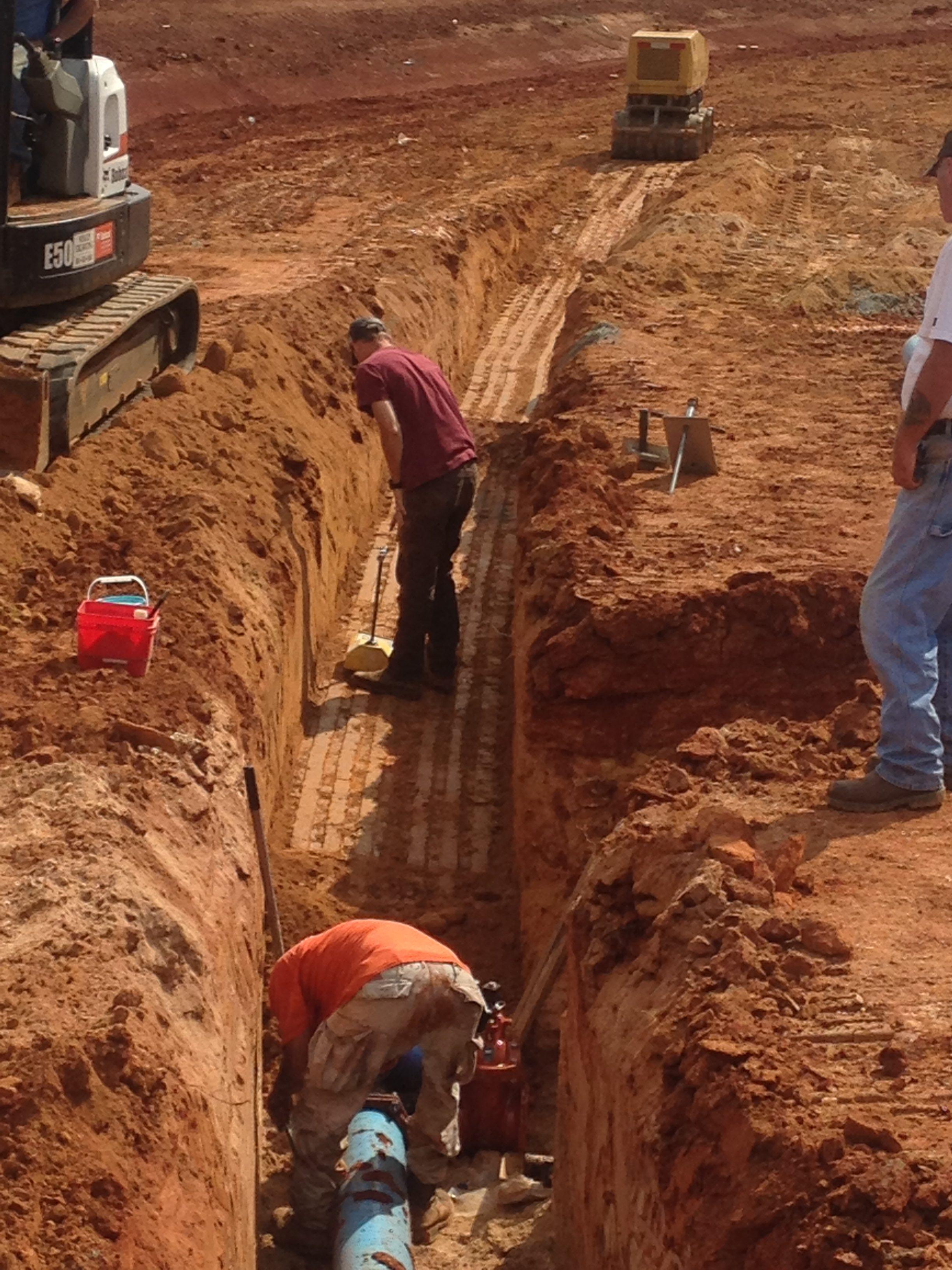 Men Working on Drain Installation